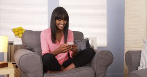 Black woman using smartphone at home