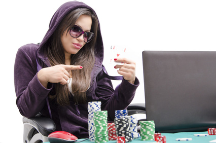 Cool girl playing online poker,showing off with two aces